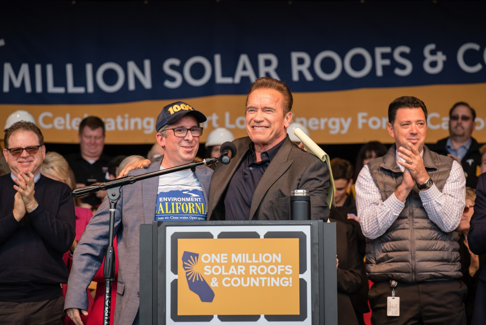 Environment California's Dan Jacobson celebrates reaching the Million Solar Roofs milestone alongside former Governor Schwarzenegger (photo credit: Tomas Ovalle)