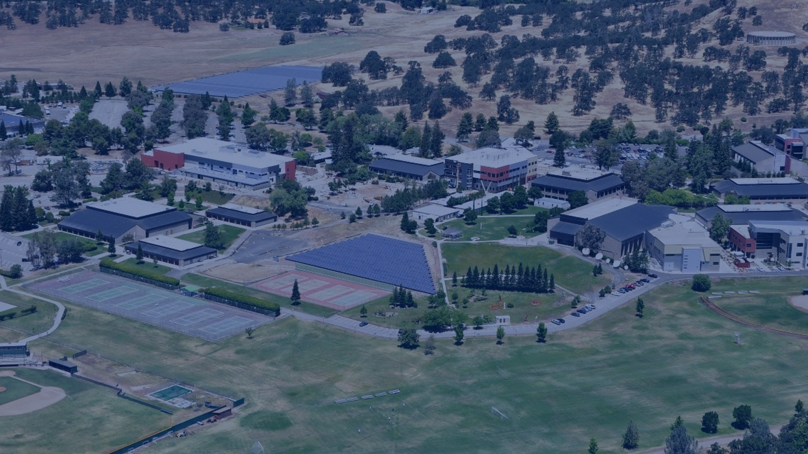 "<h4>Butte College, California</h4> <h5>In 2011, Butte College became the nation's first college campus to become ""grid positive,"" meaning that the college generated more electricity than it used, thanks to 25,000 solar panels installed since 2005. <a href=""#one""><u>Learn more.</u></a> </h5> <em>Butte College</em>"